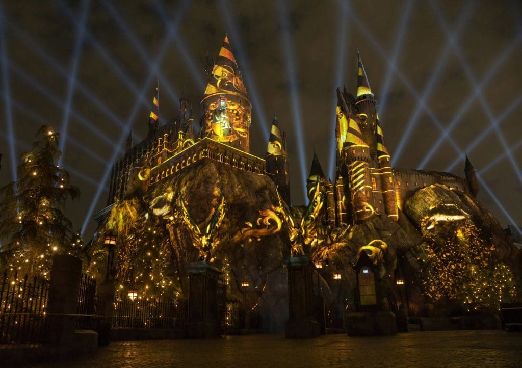 Hogwarts Castle adorned in Hufflepuff colors for The Nighttime Lights at The Wizarding World of Harry Potter - Hollywood